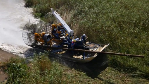 MTT Turbine Powered Airboats for Sensitive Wetland Work – MTT Turbine Airboat Exiting Water and Driving on Dry Land - http://marineturbine.com/turbine-powered-workboats/